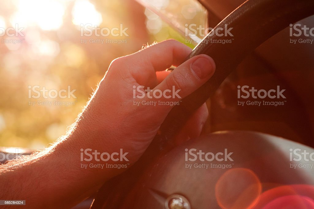 Safe Driver. Man driving his car. Hand on the steering-wheel stock photo