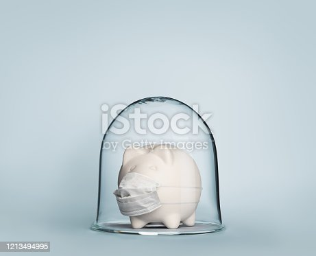 Safe economy under coronavirus concept image with piggy bank under glass jar wearing mask for protection against viruses