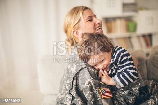 istock Safe in mommy soldier's hug 467271542
