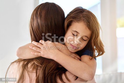 466231012istockphoto Safe in mom's arms 547218502