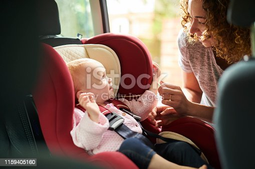 car seat mother and daughter