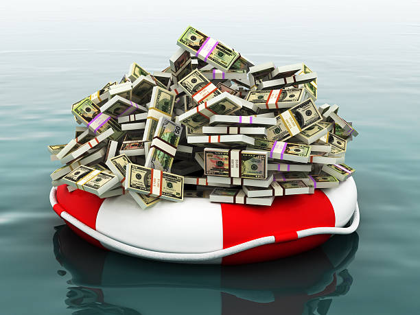 Safe money concept Large pile of money floating on a life preserver. bailout stock pictures, royalty-free photos & images