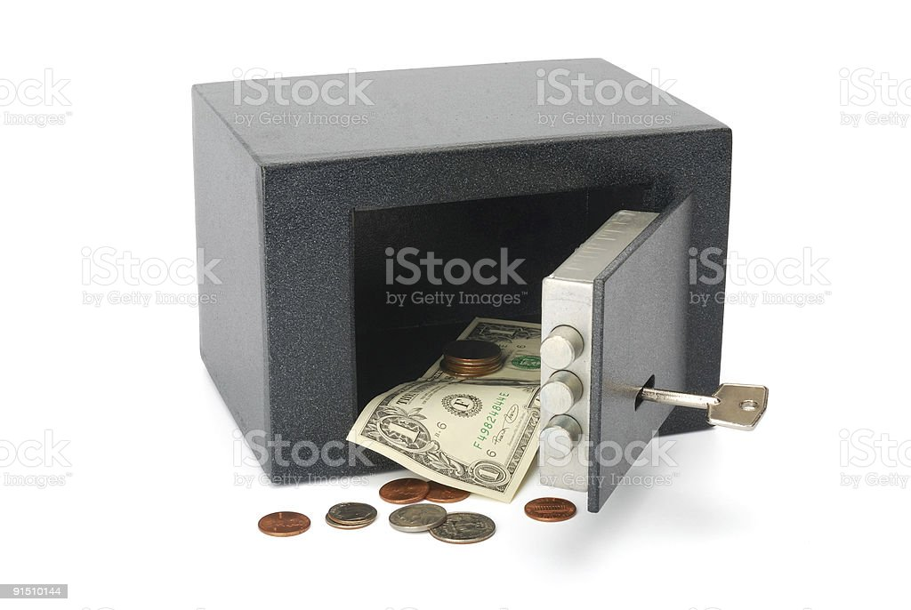 Safe with a Dollar bill and coin stock photo
