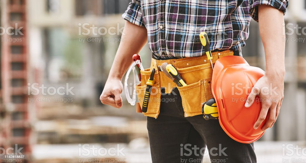 Safe work. Cropped photo of male professional builder with...