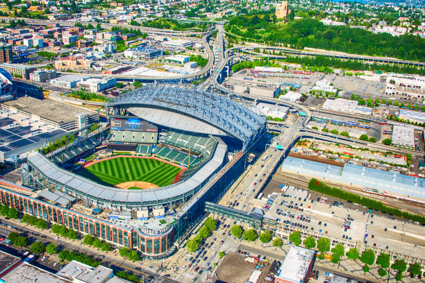 Safeco Field Aerial Seattle, United States - June 6, 2016:  Safeco Field, the home of Major League Baseball's Seattle Mariners, as shot from an orbiting helicopter at an altitude of about 1000 feet on a clear summer afternoon. major league baseball stock pictures, royalty-free photos & images