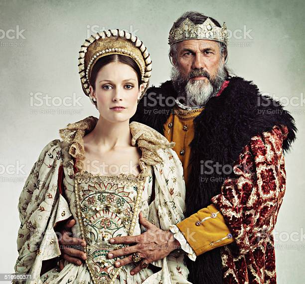 Studio portrait of a stern-looking king and queen