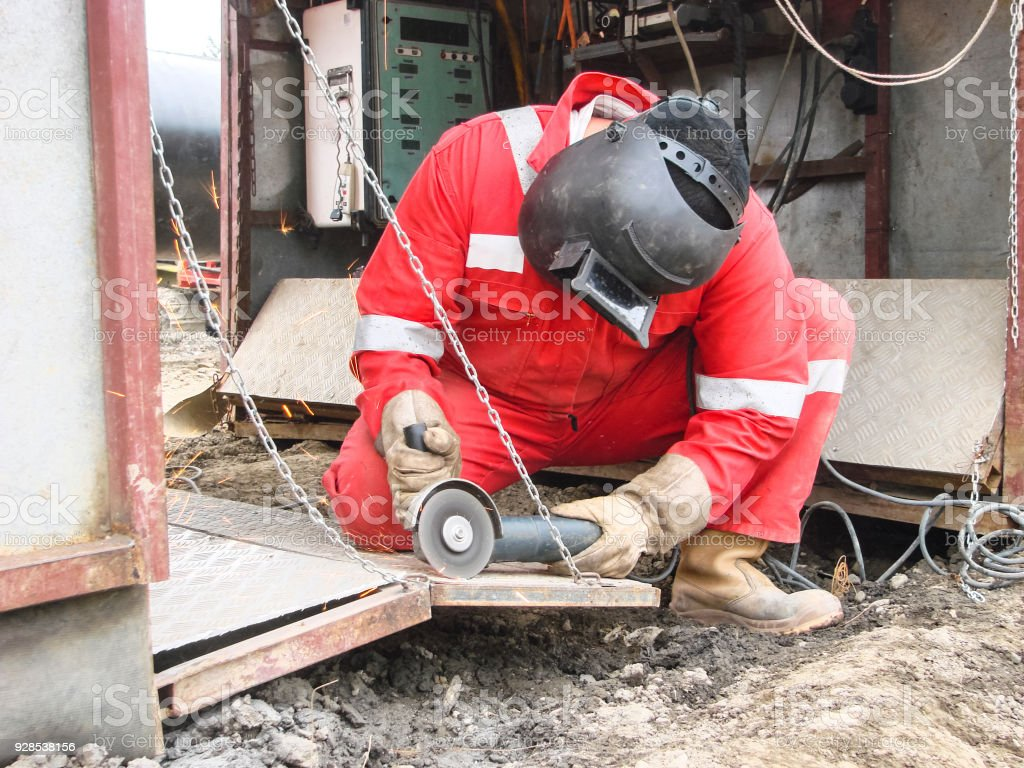 Safety at work. Welding and grinding of iron constructions. Industrial weekdays welders and fitters stock photo