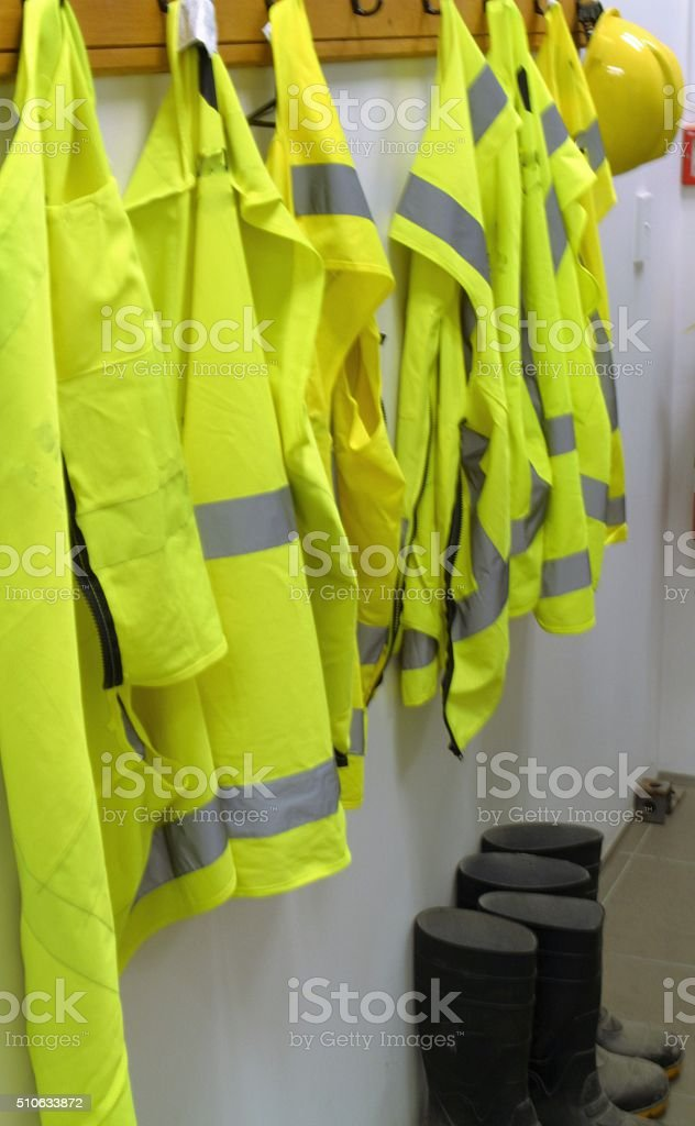 Safety at work-high vis vests, boots and hat stock photo