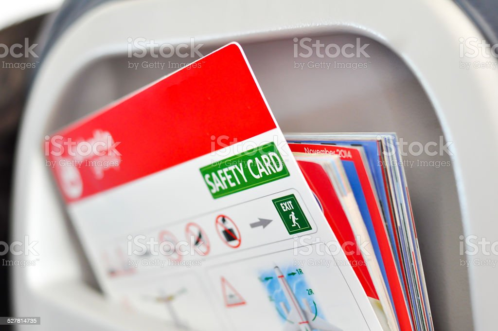 Safety card instructions in an airplane stock photo