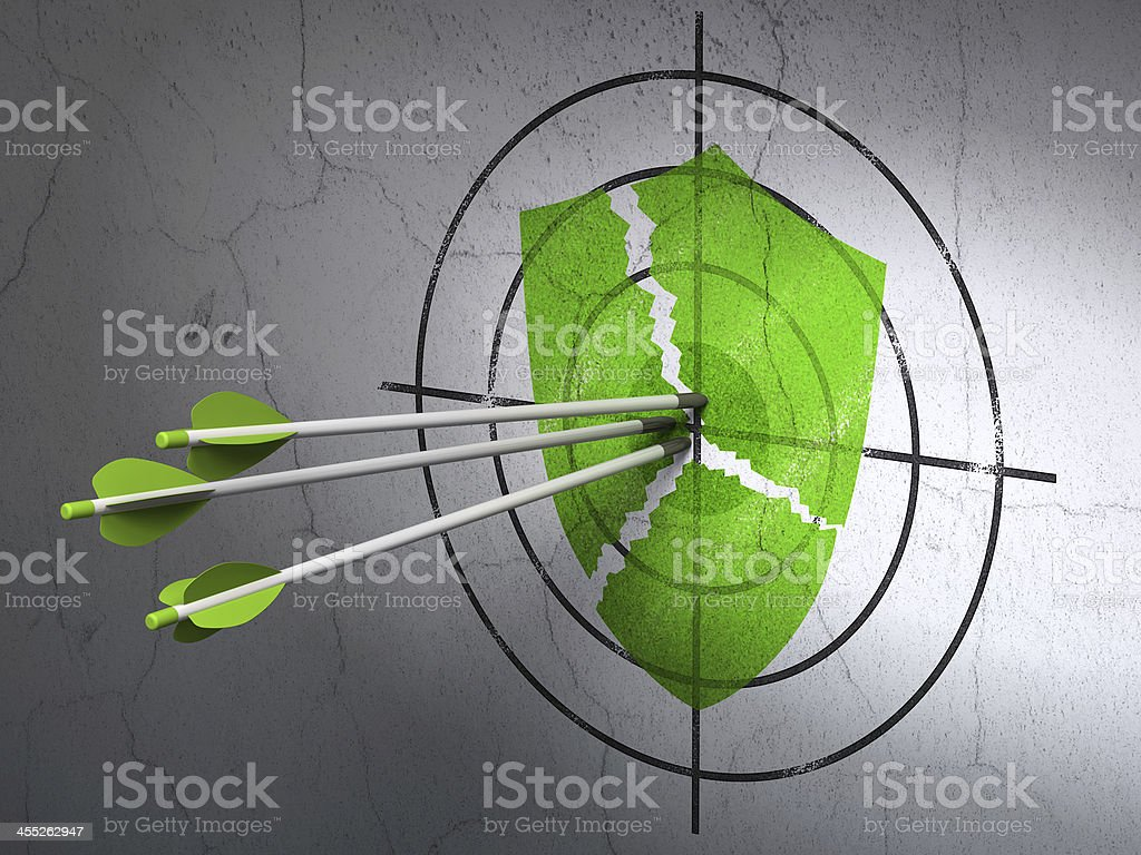 arrows hitting the center of Green Broken Shield target on wall...
