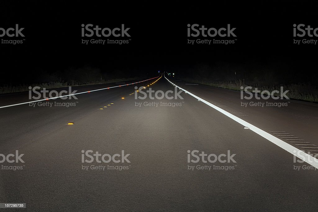 Safety concept: night drive on a fresh paved road stock photo