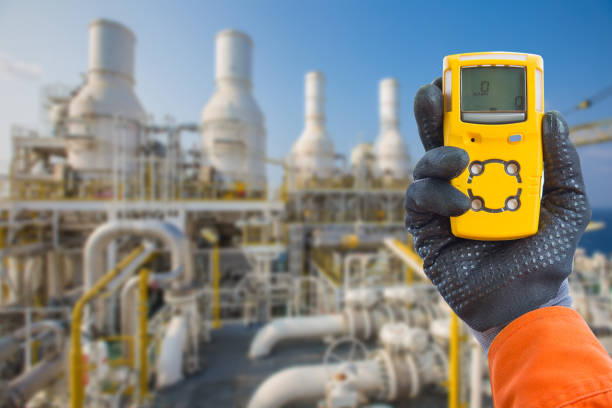 Safety concept of safety and security system on offshore oil and gas processing platform, hand hold gas detector for check hydrocarbon leak to protect fire and explosion. Safety concept of safety and security system on offshore oil and gas processing platform, hand hold gas detector for check hydrocarbon leak to protect fire and explosion. sensor stock pictures, royalty-free photos & images