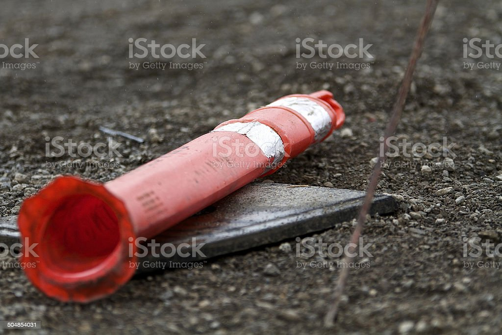 Safety concept or idea with delineator sign damaged lying down stock photo