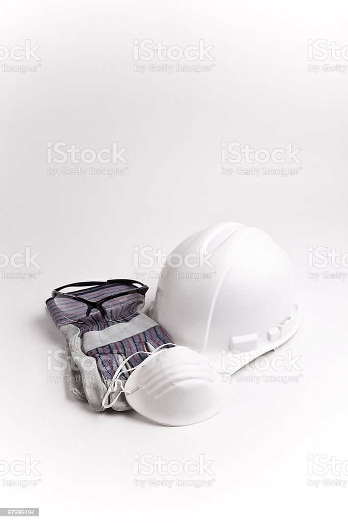 Safety equipment hard hat glasses gloves mask royalty-free stock photo