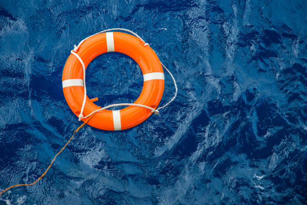 Safety equipment, Life buoy or rescue buoy floating on sea to rescue people from drowning man. Safety equipment, Life buoy or rescue buoy floating on sea to rescue people from drowning man. buoy stock pictures, royalty-free photos & images