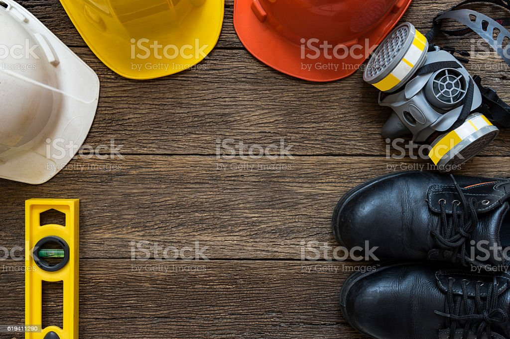 Safety equipment on old wooden table, top view stock photo