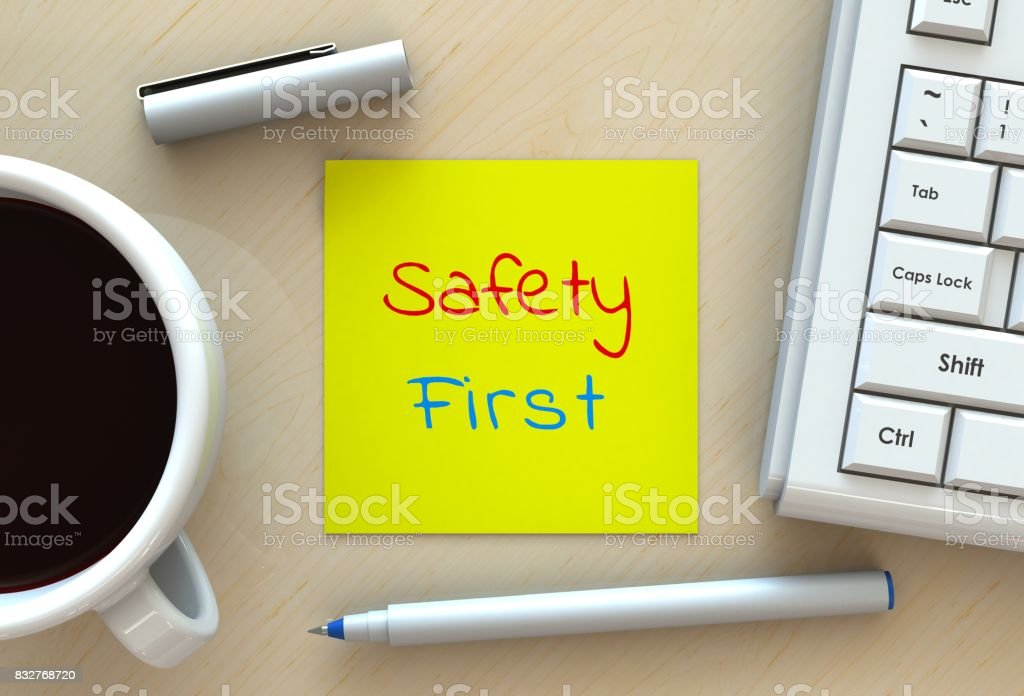 Safety First, message on note paper, computer and coffee on table, 3D rendering stock photo