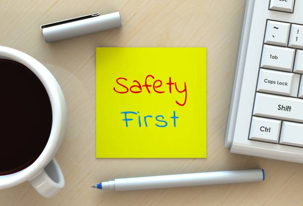 safety first, message on note paper, computer and coffee on table, 3d rendering - safety stock pictures, royalty-free photos & images