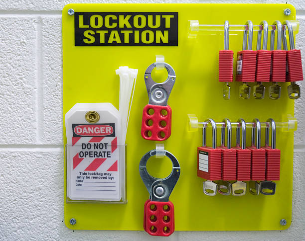 Safety first padlocks and keys An industrial lockout station promotes safety lockout stock pictures, royalty-free photos & images