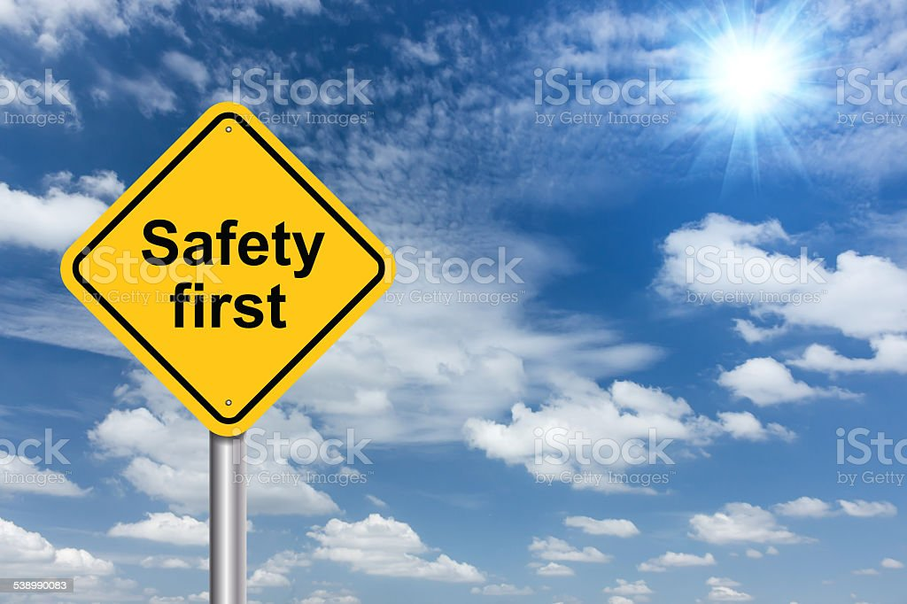 safety first sign banner and clouds blue sky background stock photo