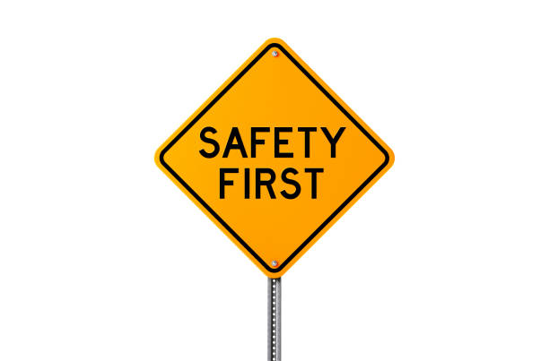 safety first sign isolated on white background - safety stock pictures, royalty-free photos & images