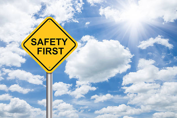 safety first sign on blue sky - number 1 stock pictures, royalty-free photos & images