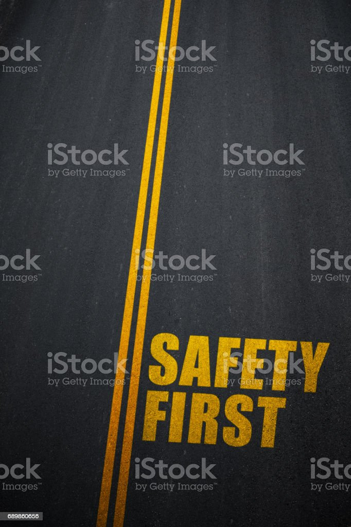 Safety First text on asphalt road stock photo