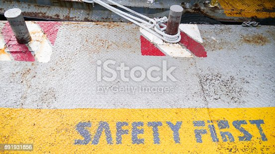 istock safety first yellow label floor sign symbol on grey metal texture background 891931856