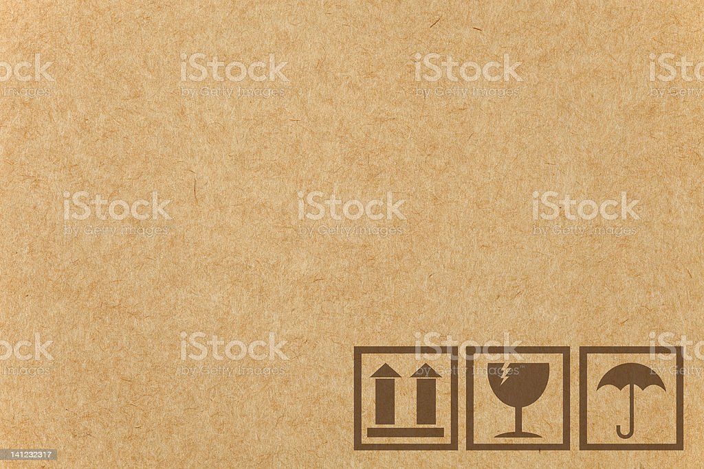 Safety fragile icon on cardboard paper box with space royalty-free stock photo