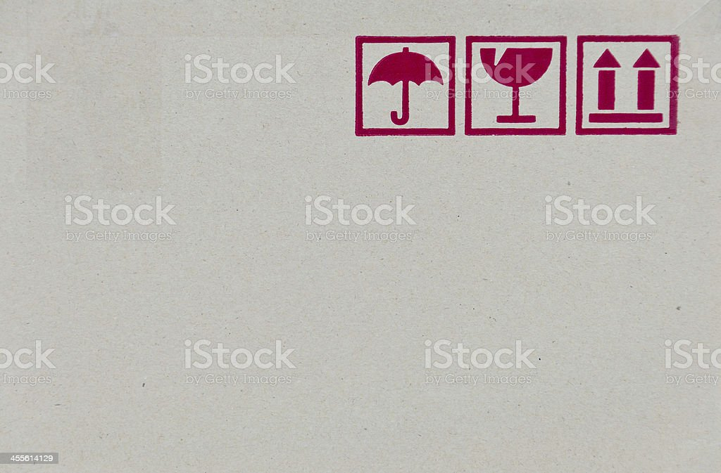 Safety fragile icon on cardboard paper box with space stock photo