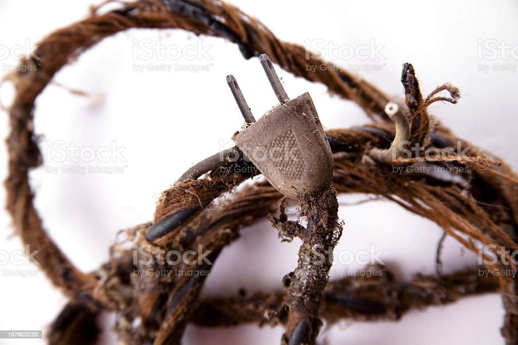 Safety.  Frayed old electrical cord, plug. Safety hazard. stock photo
