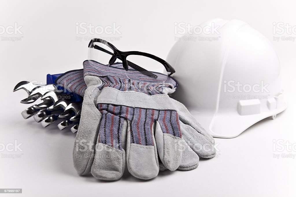safety gear hard hat gloves glasses wrenches royalty-free stock photo