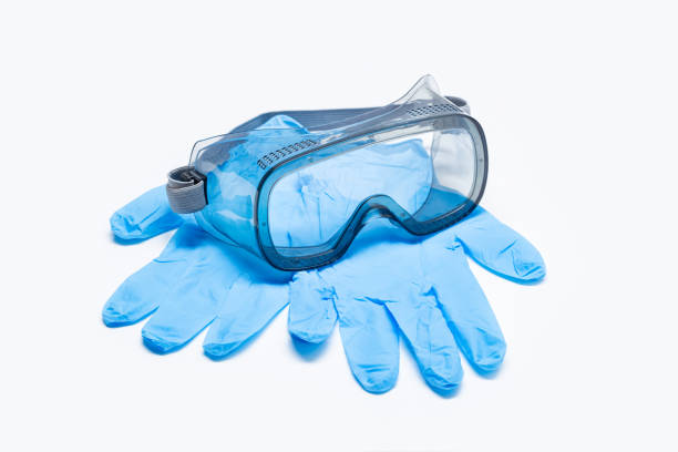 Safety glasses and protective glove isolated on white background stock photo