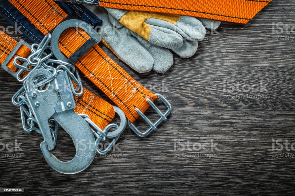 Safety gloves construction body belt on wooden board top view royalty-free stock photo