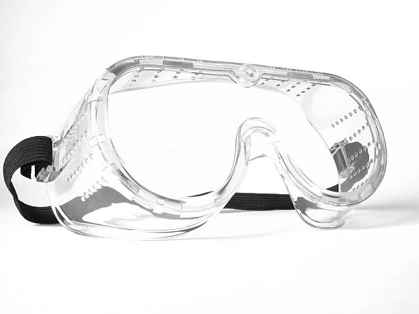 Safety Goggles New safety goggles or glasses on a white background. protective eyewear stock pictures, royalty-free photos & images