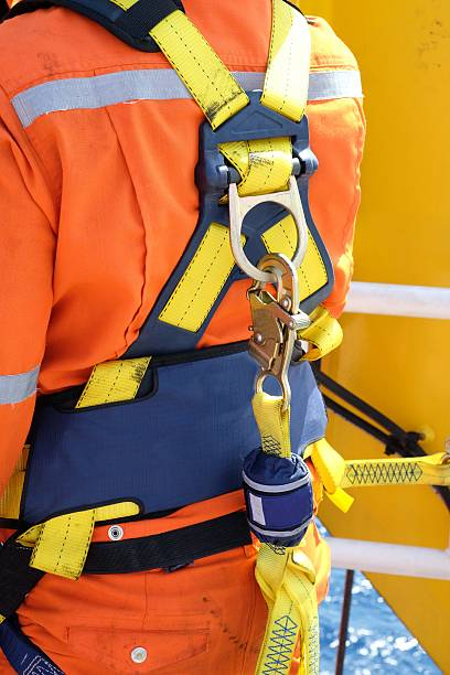 safety harness construction site worker at offshore with safety harness. safety harness stock pictures, royalty-free photos & images