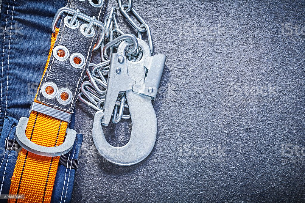 Safety harness with metal chain carabiners on black background c stock photo
