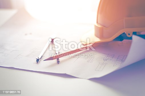 623909418 istock photo safety hats on the desk 1191985176