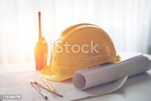 623909418 istock photo safety hats on the engineer's desk 1191984795