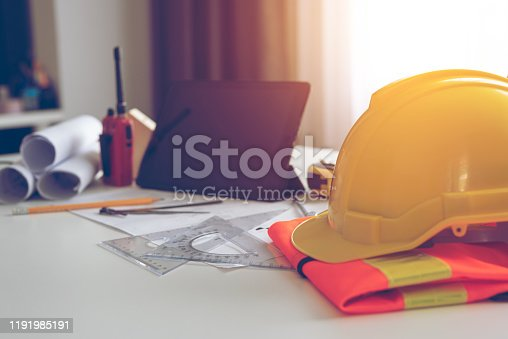 Drawing equipment and safety hats on the engineer's desk