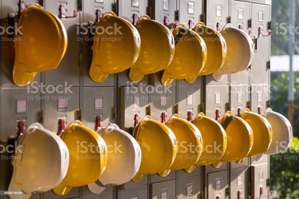 Safety helmet hanging stock photo