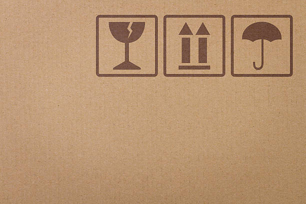 safety icons on a cardboard box - fragile stock pictures, royalty-free photos & images