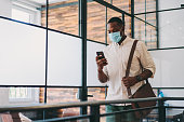Businessman wearing mask in the office during COVID-19 pandemic