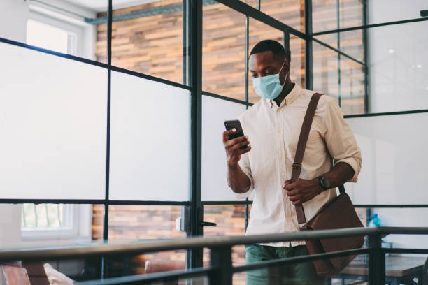 Safety in the office during COVID-19 pandemic, businessman with face mask stock photo