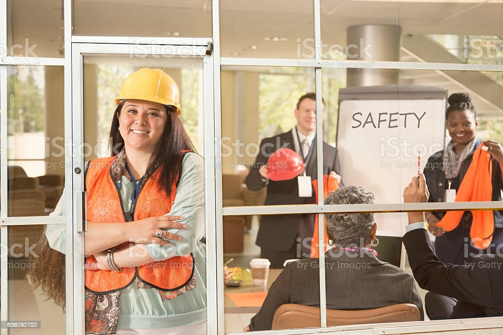 Safety in the workplace presentation to construction workers. stock photo