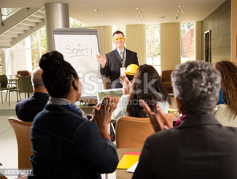 istock Safety in the workplace. Presentation with office workers. 483095837