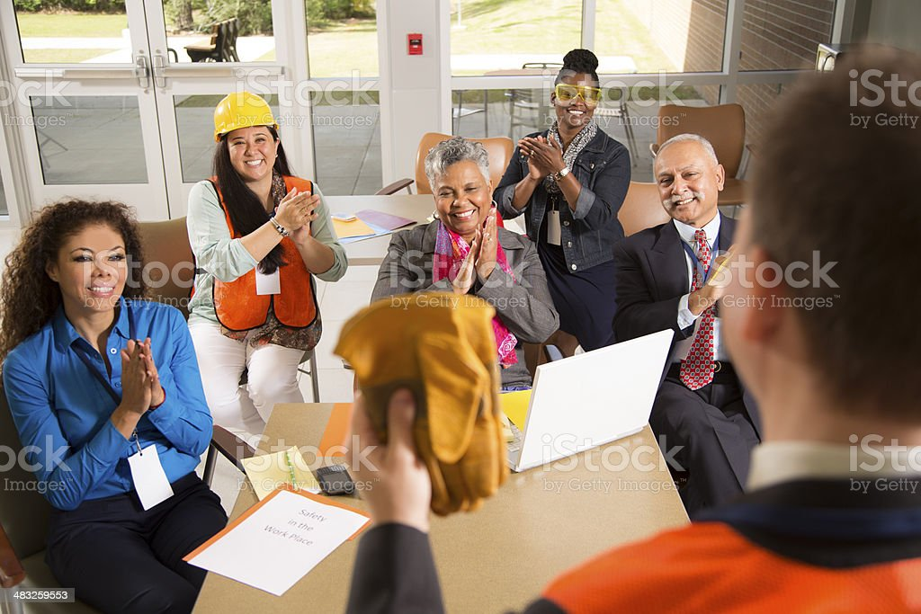 Safety in the workplace. Presentation with office workers. stock photo