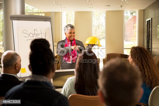 istock Safety in the workplace. Presentation with office workers. 484623003