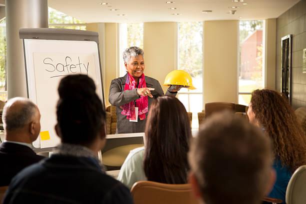 safety in the workplace. presentation with office workers. - arbetssäkerhet bildbanksfoton och bilder