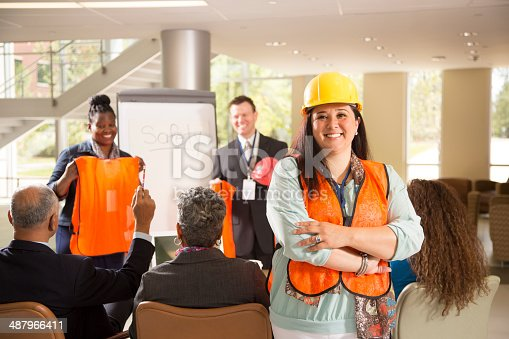 istock Safety in the workplace. Presentation with workers. 487966411